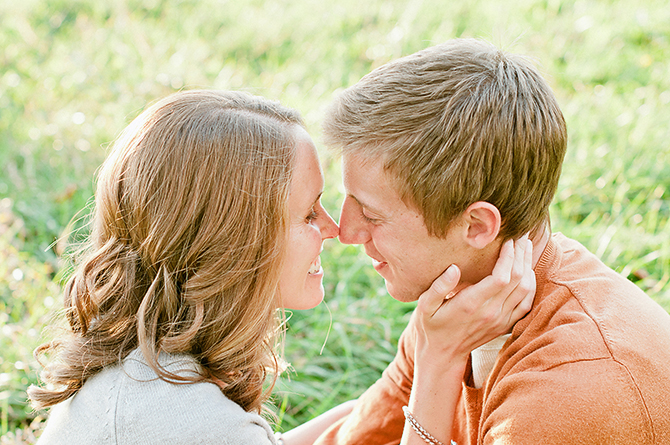 happy couple in a field engagement pictures in dayton