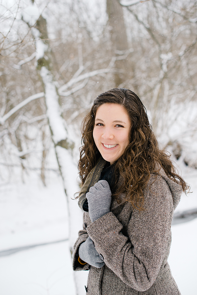 senior girl photograph in dayton smiling in the snow