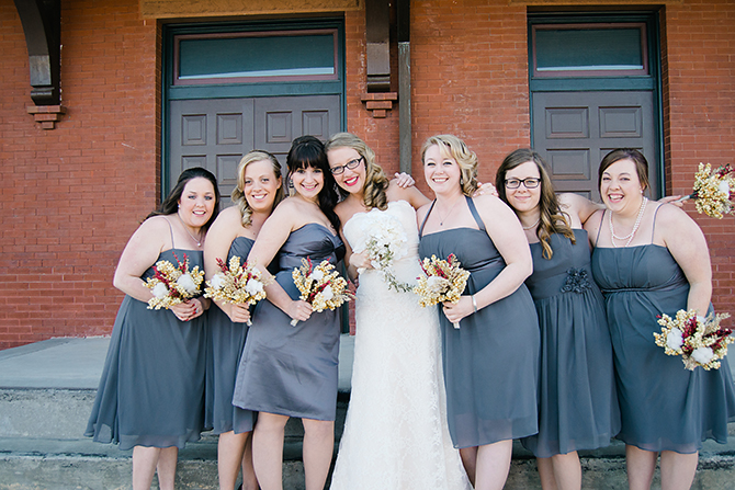 bride with her bridesmaids grey dresses