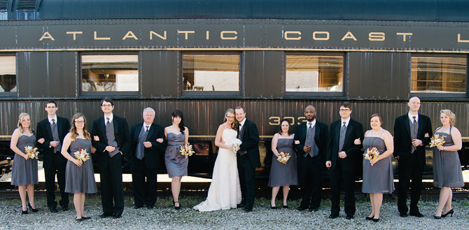 bridal party with old train at rocky mount, nc amtrak station