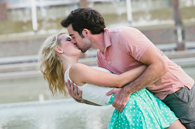 engagement couple kissing in fountain at miami university