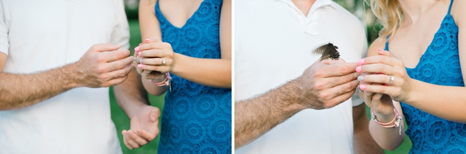couple releasing butterfly in engagement photos