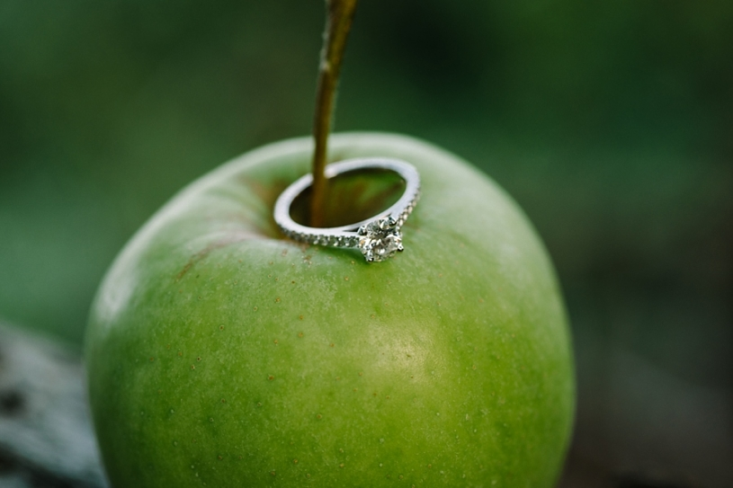 engagement ring on an green apple