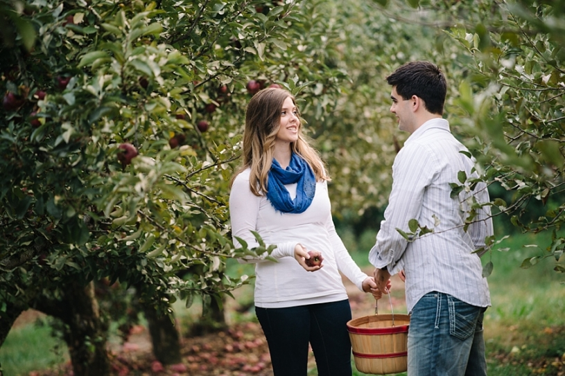 engagement pictures in an apple orchard