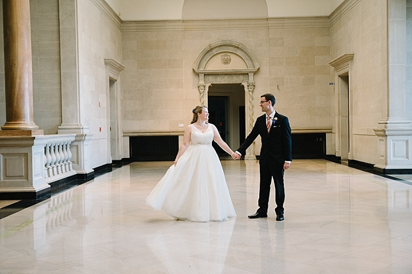 bride and groom in great hall at dayton art institute