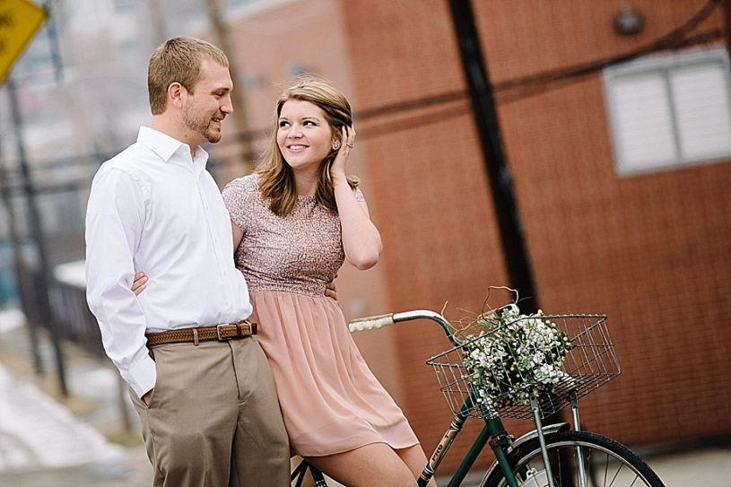 engagement photos with vintage bike in downtown dayton