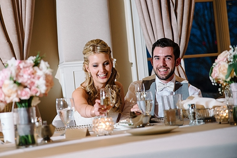 bride and groom laughing at toast