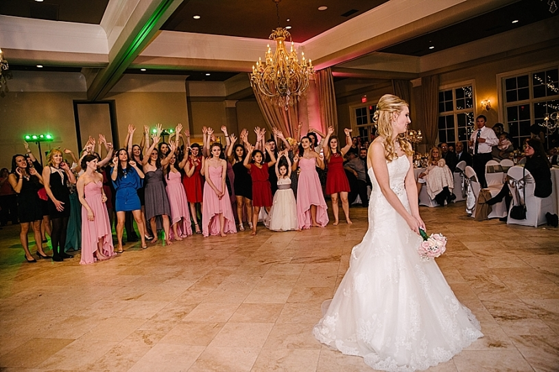 bride tossing bouquet at pinnacle golf club